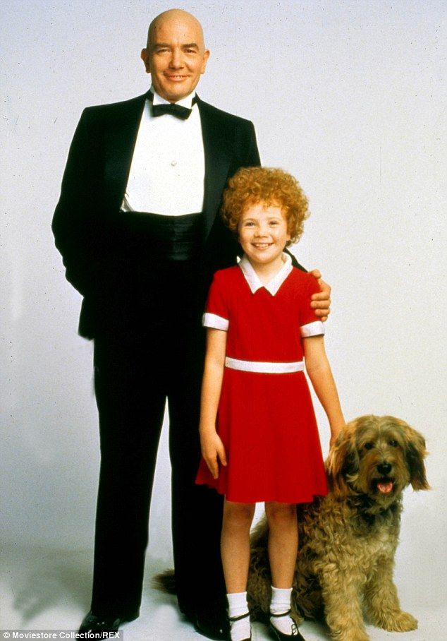 Hard knock life: Aileen Quinn, posing with Albert Finney, wore a similar frock in the 1982 film Annie