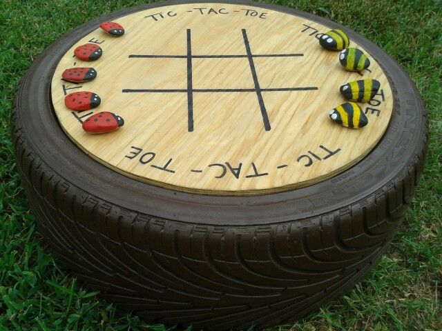 Tic Tac Toe yard game...used old tire, spray painted to match shutters, stained plywood, painted rocks per another pin