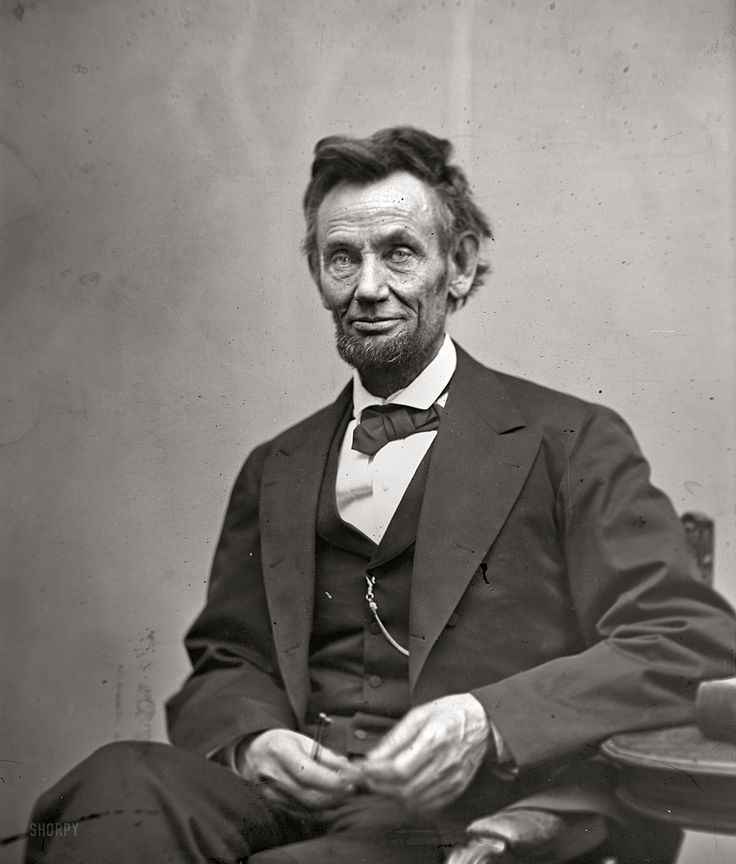 February 5, 1865.  Abraham Lincoln, seated, holding spectacles and a pencil. This photo was taken just two months before President Lincoln was killed.    -photograph by Alexander Gardner