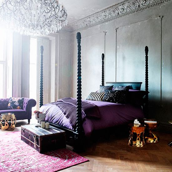 Bedroom Ideas: Vintage Gray Master Bedroom with Sleek Purple Bedding also Brass Bedside Tables plus Crystal Chandelier and Black Canopy Bed
