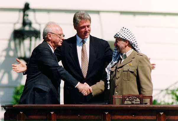 Bill Clinton, Yitzhak Rabin and Yasser Arafat at the Oslo I signing ceremony, September 13, 1993. Photo: Wikipedia.