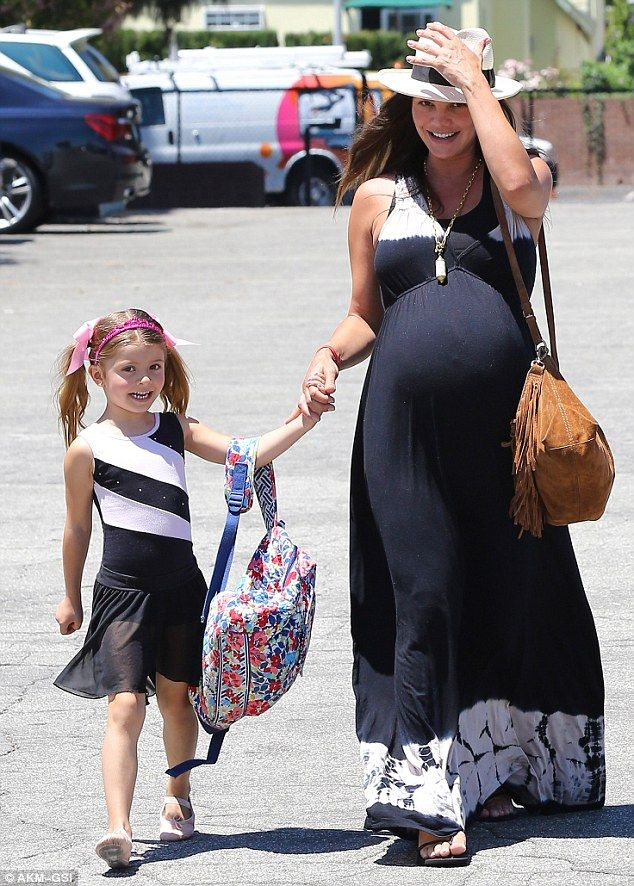 Glowing: Heavily pregnant Ali Landry proudly escorted her daughter Estela into her dance recital on Thursday, as they were both unable to hide their beaming smiles