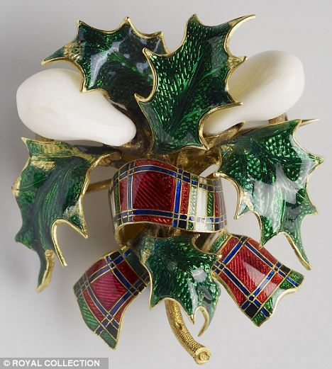 A pair of teeth set in thistle with a tartan ribbon - another brooch made with stag teeth and presented to Queen Victoria by Albert.