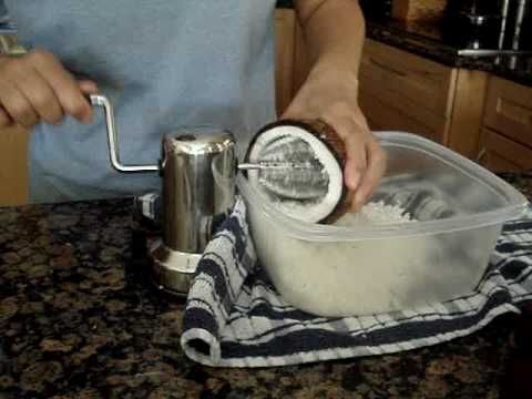 coconut grater in action - YouTube