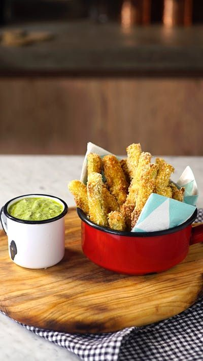 Got that craving for fries, but want something healthier? Try these crispy zucchini fries with a yogurt pesto sauce.
