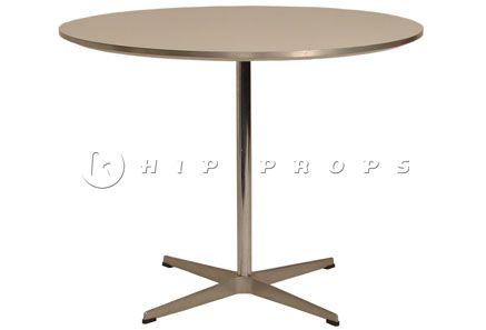 Swan dining table designed by Arne Jacobsen 1957. Available to hire from  http://www.hipprops.com/Jacobsen,_Arne/Swan_dining_table