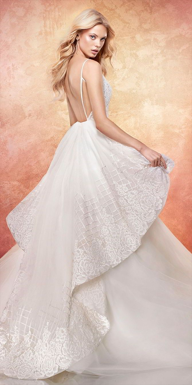 Ivory floral trellis embroidered tulle bridal ball gown, spaghetti strap bodice with deep sweetheart neckline, low open back, tiered skirt with embroidery and lace accent.