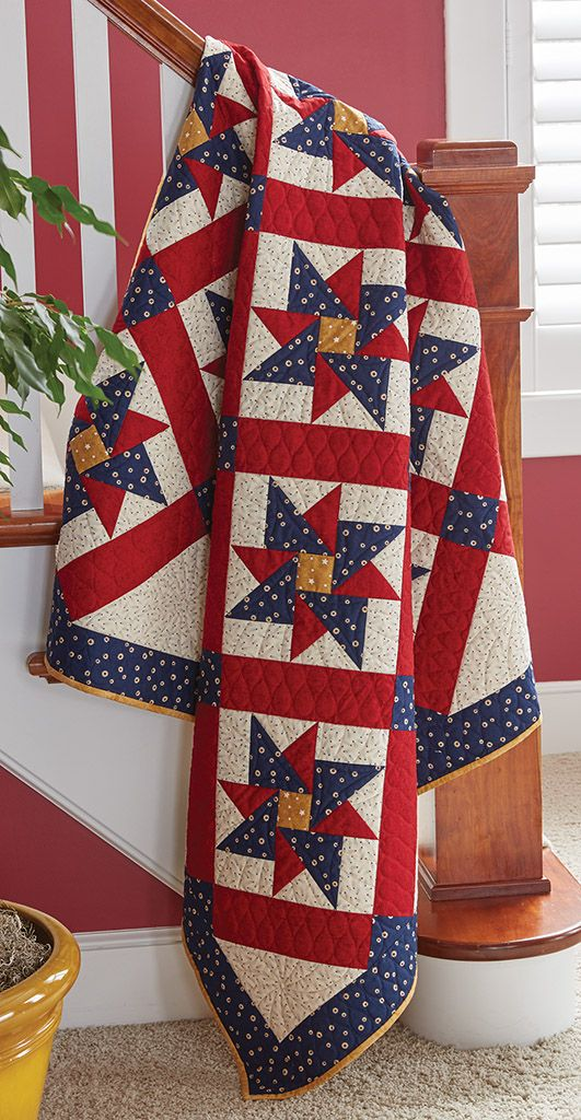 """Marianne Fons chose a classic Pinwheel Star block for her latest Quilt of Valor®. Our Sew Easy Lesson walks you through cutting half-square and quarter-square triangles. About This Quilt Finished Size: 61″ x 79½"""" Finished Blocks: 18 (10″) blocks Rating: Intermediate Designed by: Marianne Fons Recommended Tools: Fons & Porter Half and Quarter Ruler, Fons…"""