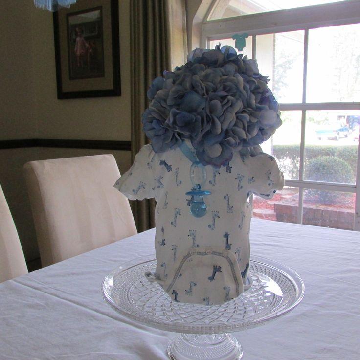 Onesie centerpiece month around a fat vase