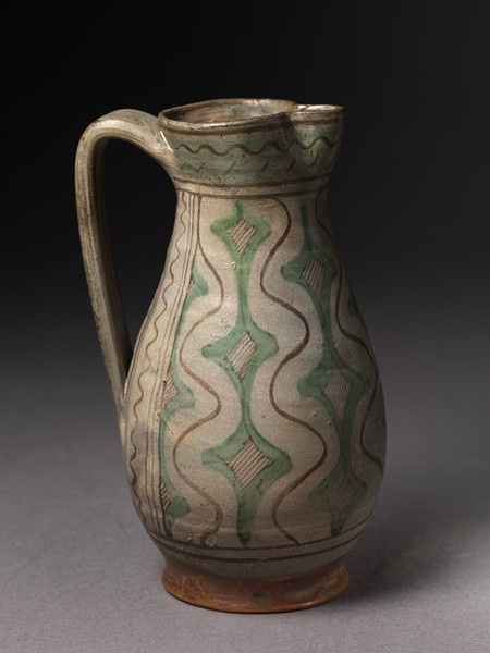 Jug - Tuscany, end of 14th or early 15th century. Tin glazed earthenware painted in copper and manganese