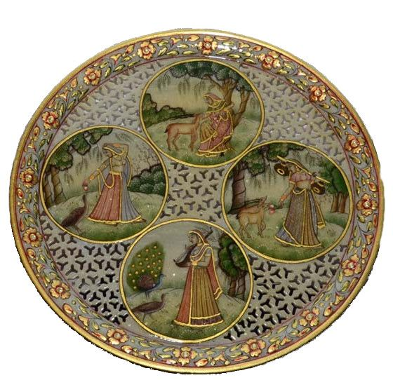 It is a marvelous painting done on marble with traditional colors showing Ragini's life. It is depicting a beautiful lattice pattern and kundan work. Boundary of a plate is painted with beautiful flowers and leaves. Marble has been cut in design for attractive look. For its incredible appeal, it serves as a great gift for your loved ones. Click here to buy this product - www.kalakhoj.com