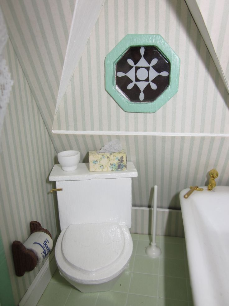 In keeping with the color of the room i painted the window trim mint green