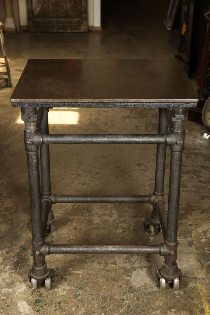 1stdibs.com | Cast Iron Industrial Table with Dual Wheels