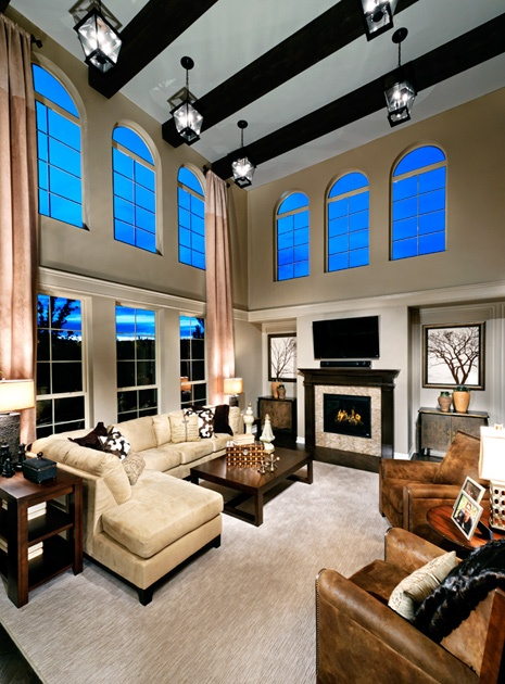 Toll brothers soaring two story family room for relaxing in style furniture arrangement - Family room design ideas ...