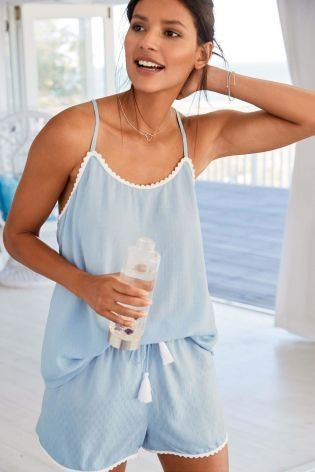 4c9f98eeef49 A live-in shorts set designed in a soft blue hue
