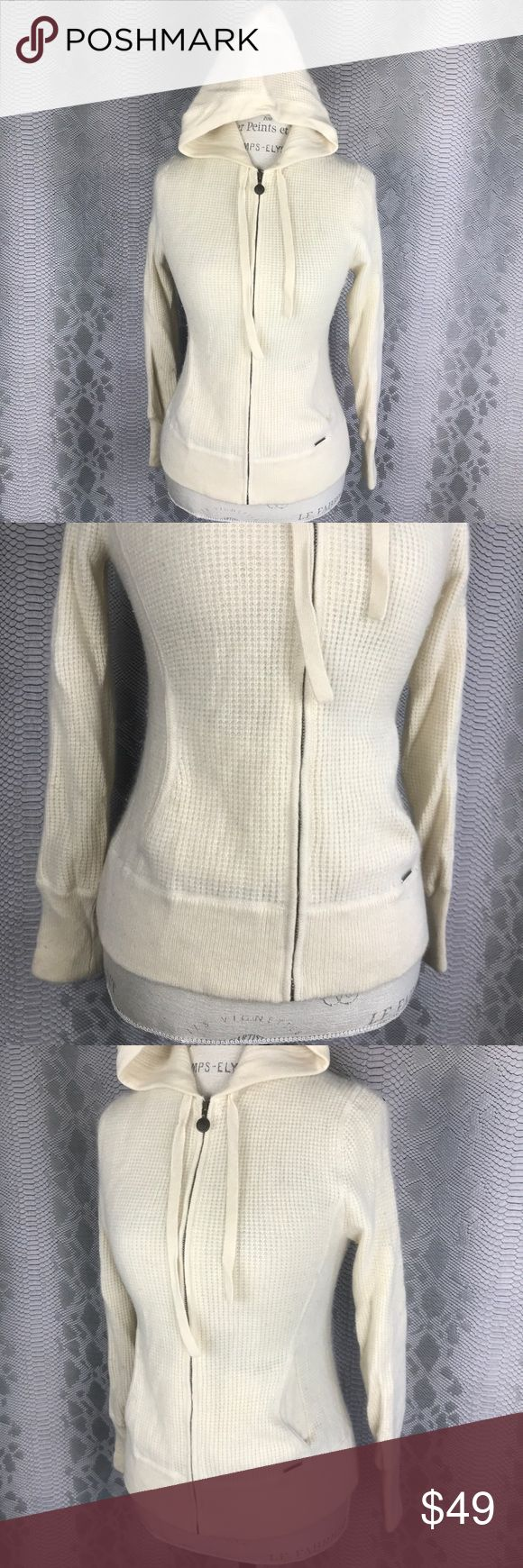 Ugg cream zip up hooded sweater w Pockets Good condition . Fuzzy furry zip up hooded sweatshirt  Two outside pockets Adjustable hoodie Full zip with ugg branded zipper UGG Jackets & Coats