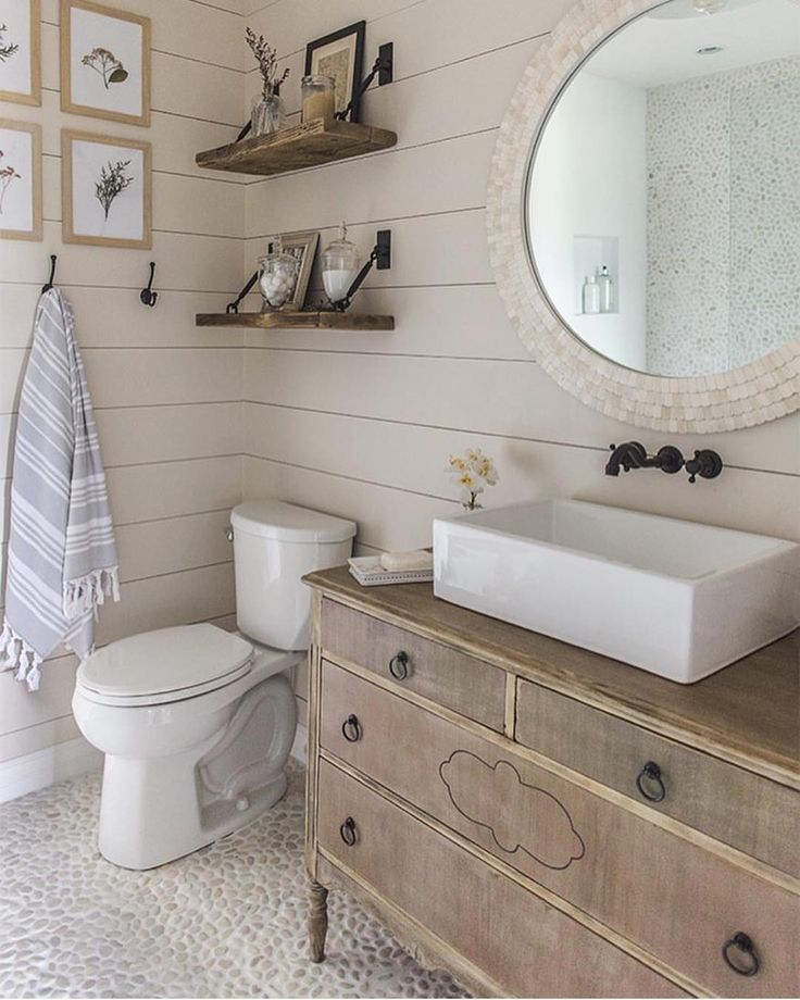 I've been loving shiplap walls in bathrooms for a while now. I didn't realize just how much until I went through my Pinterest bathroom board a few days back and found the darn things all over the place. #shiplap #shiplapBathroom #ShiplapWall
