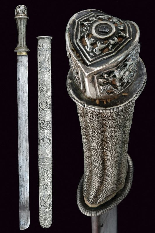 A silver mounted sword   provenance:Bhutan dating: 19th Century
