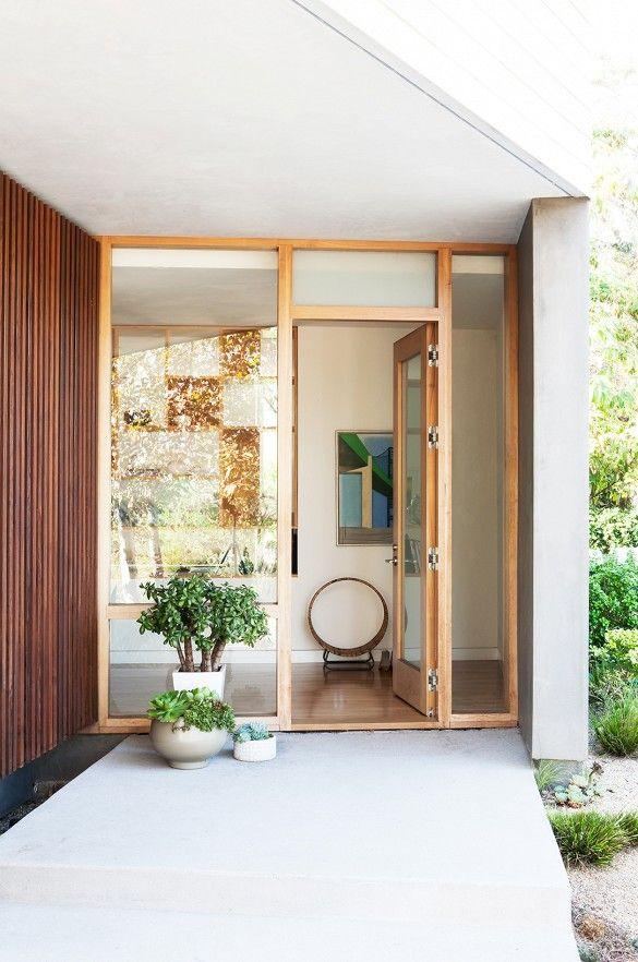 Modern glass front door design.