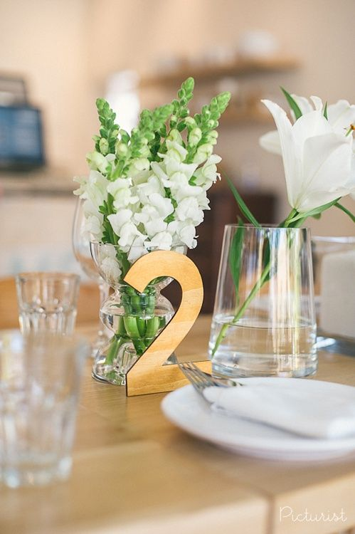 Beautiful neutral wedding decor. Love the wood table numbers. From Carla & Werner's wedding at Maison Estate in Franschhoek.