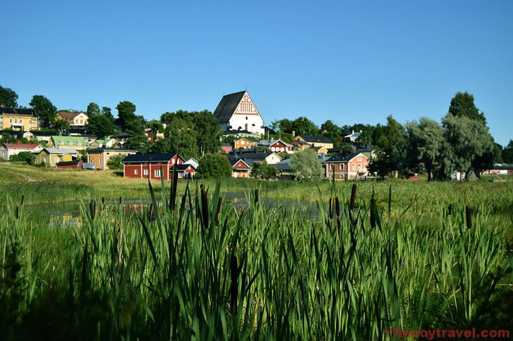 Porvoo Old Town is a combination of natural beauty and traditional Finnish wooden architecture. At the background there is the Porvoo Cathedral.