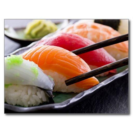 Sushi with chopsticks postcards
