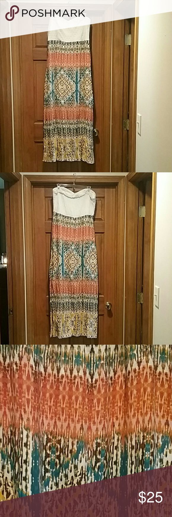 """Maurices tribal maxi dress Maurices XXL tube maxi dress. Top to bottom is 51"""" with a 22"""" slit on each side. Dress is lined. Sticky tape built into top to help hold it up. Front of top had lace overlay. Back is cinched and stretchy. Colorful tribal like print. maurices Dresses Maxi"""