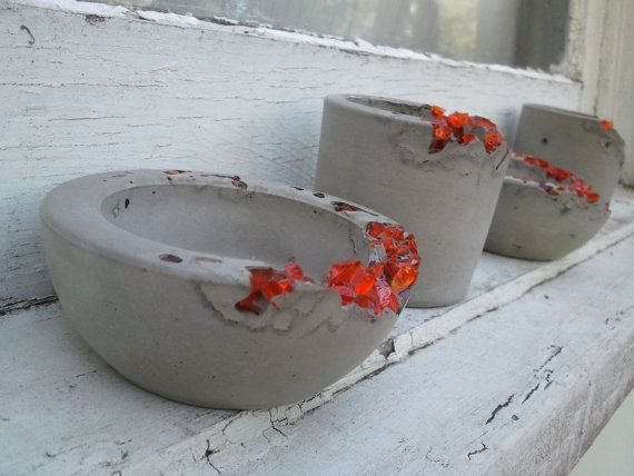 interesting...coloured glass rubble used in exposed edge..................................... irregular concrete pots