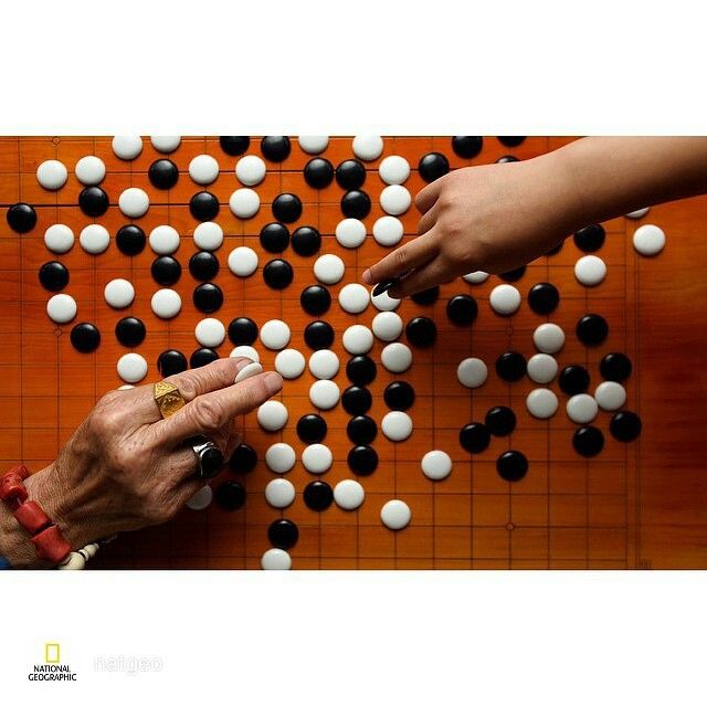 #ShareIG repost via from @natgeo Young hand, old hand @ Chinese board game. @joemcnallyphoto #Beijing #picoftheday #onassignment #istanbulgookulu #go #baduk #game