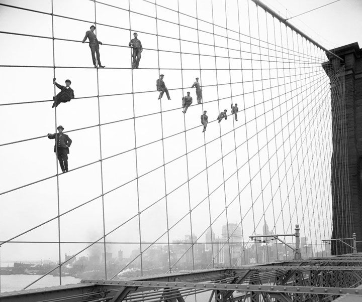 painters suspended on cables of the brooklyn bridge, october 7, 1914. NYC. eugene de salignac / courtesy NYC municipal archives