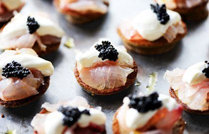 Citrus-cured sea bass on blinis with ossetra caviar and crème fraiche - Robert Thompson - See more at: http://www.greatbritishchefs.com/recipes/sea-bass-blinis-recipe#sthash.0sDnwaTI.dpuf