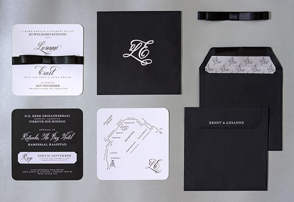 Formal black and white invitations on thick canvas paper, incl. detachable RSVP card with contact details. Black double-atin bow hold invite and map cards together in a lined black envelope with their logo and guest names printed in metallic silver ink.