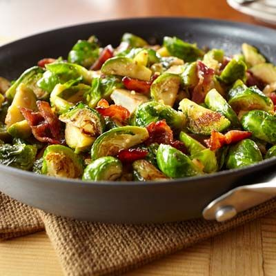 Give brussels sprouts an upgrade with garlic, herb, and candied bacon. Yum!