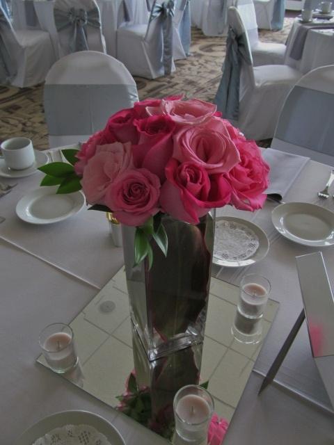 Medium cube pink rose centerpiece with foliage submerged