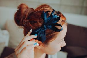 Romantic hairstyle for red hair. Headband.