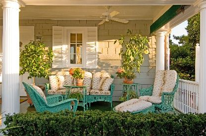 Love the colorful furniture and fabric. Nice shutters and columns too.