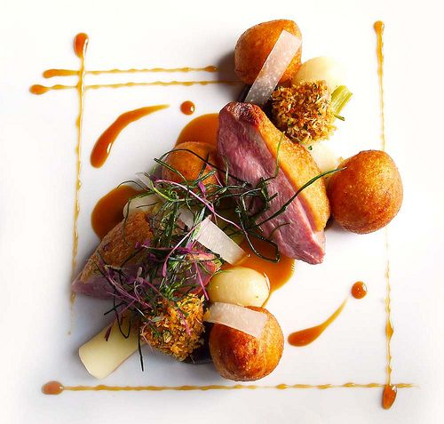 Gressingham duck , roasted breast and pan fried liver, Plum sauce, Leeks, Turnips and Dauphine potatoes.