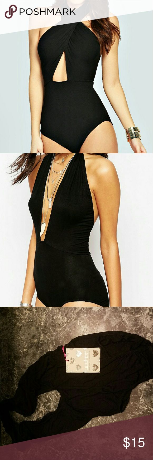 "NWT BOOHOO Sophie Wrap Front Halter Neck Bodysuit NWT  BOOHOO Size 10 or M/L  36-39"" Bust 29-31"" Waist 39-42"" Hips  Black 'Sophie Wrap Front Halter Neck Bodysuit'  95% Viscose 5% Elastane Snap crotch Can be worn 2 different ways! Boohoo Tops Tank Tops"