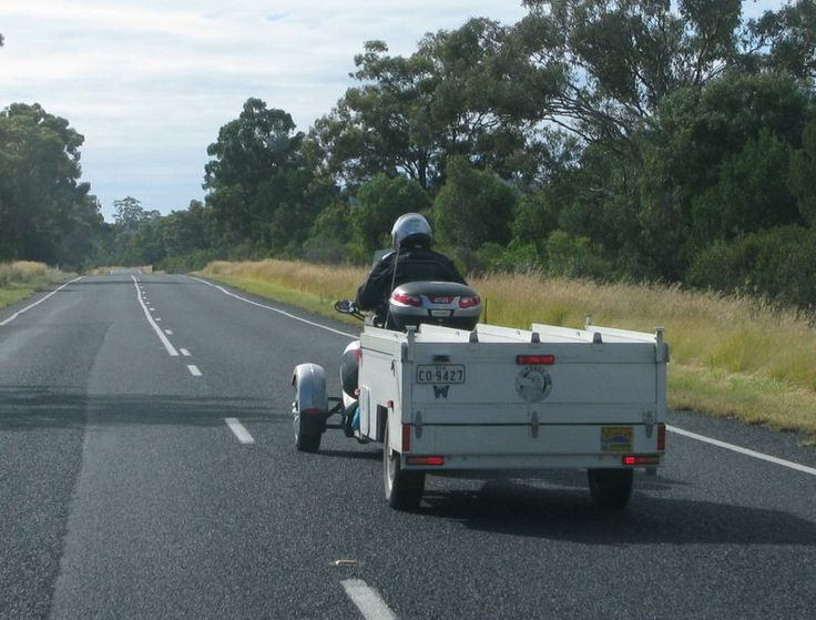 Camper van for motor cycles.  What a great idea.  Maybe the owner of the bike built it.  Looks very smart.