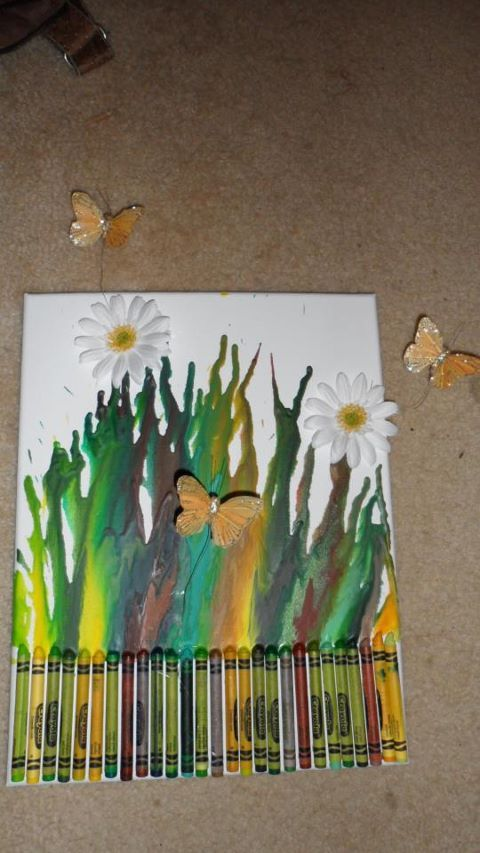 This is my first try at crayon art.  I found the daisies and butterflies at Michael's Arts and Crafts store.  It was really fun to make!
