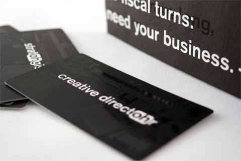 Coated Stock business card with its sheen visible.