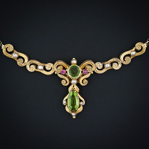 Victorian Repousse Peridot Necklace,  multi-dimensional goldsmithing distinguishes this exquisite and very special early-Victorian Peridot and Natural Pearl necklace with tiny Ruby accents. Circa 1875, it is now sold
