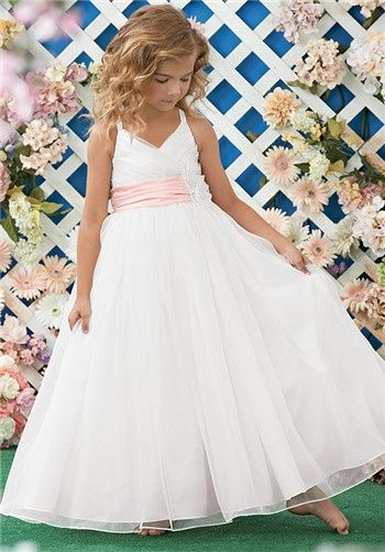 Shown in Diamond White and Light Pink…Pleated mock wrap bodice with spaghetti straps. Pleated satin waistband with embellished organza flowers. Full floor length organza skirt. Also available in ankle length.