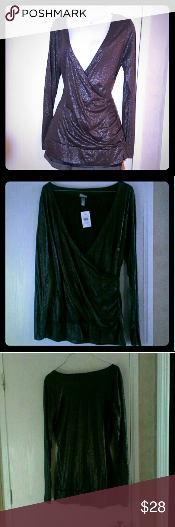 Sparkly Charcoal Slate Grey Deep V Plunge Silver Sparkly grey shirt from Vanity, size large, new with tags. Great for new year's parties!  Deep V-neck for a sexy look, or wear a cami underneath for a more conservative look.   Smoke free home. I will gladly bundle items to give you a discount (the more you buy, the cheaper I can let everything go!). Many items can be added on for only $1.  MAKE AN OFFER! Vanity Tops Blouses