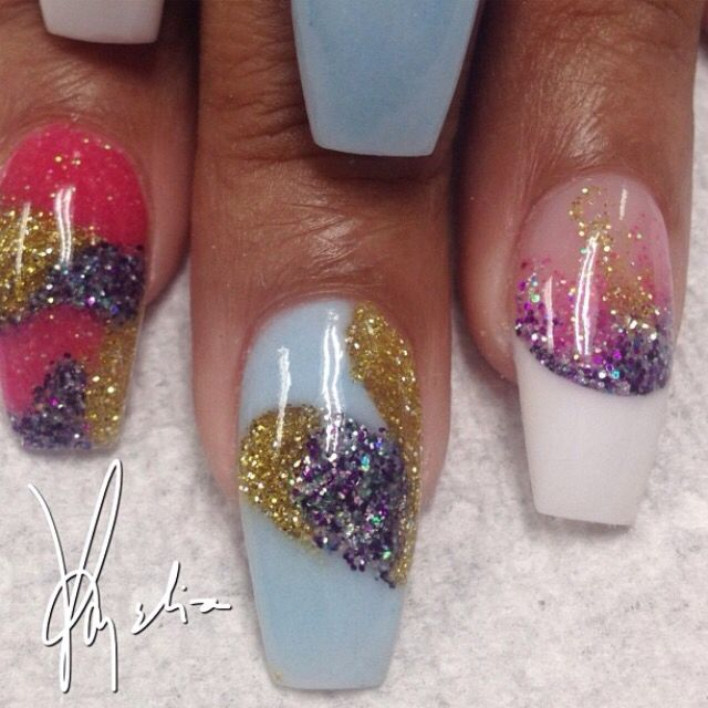 Tammy Taylor colored acrylic over tips..white (WW) acrylic at tip with 3 different glitter acrylics faded into clear acrylic..gold glitter acrylic..dark pink glitter acrylic..purple•blue•teal glitter acrylic..light blue acrylic mix... ALL FREEHAND and no drill used..