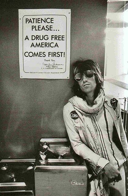 keith richards at customs in Seatle - 1972 | airport security | drugs | funny | the rolling stones | on tour | rock n roll | iconic image | 1970's | www.republicofyou.com.au