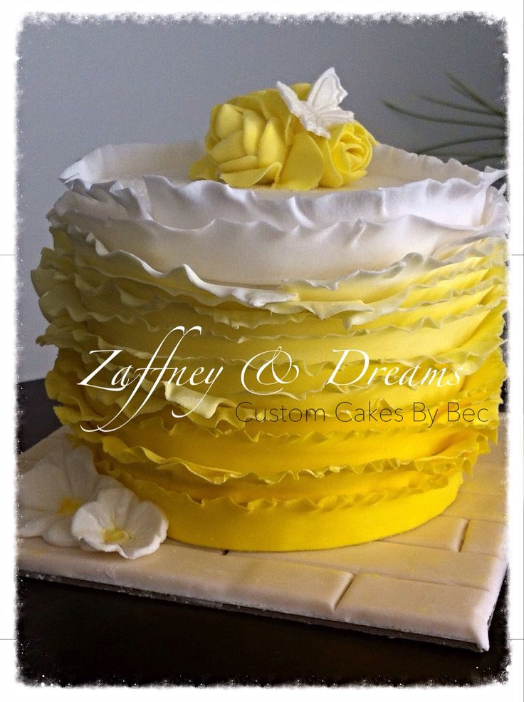 Vanilla sour cream cake  ( ombré style) with white choc ganashe, covered with ombré ruffles