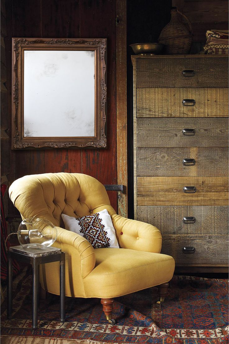 low yellow tufted chair