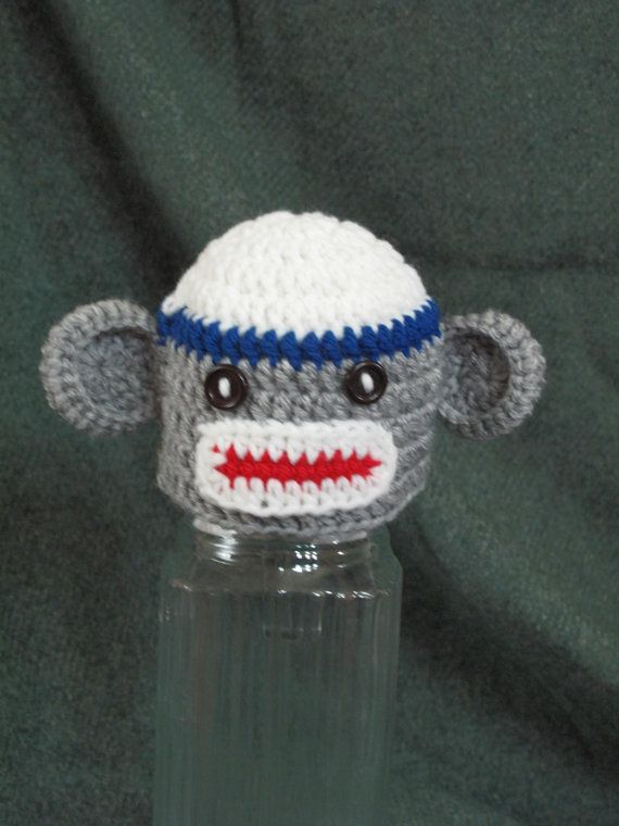 Adorable mini Sock Monkey hat for tiny babies! Also comes in pink, or other colours/sizes if you custom-order.  If you get every size you could have a family of sock monkeys at Christmas time! :)