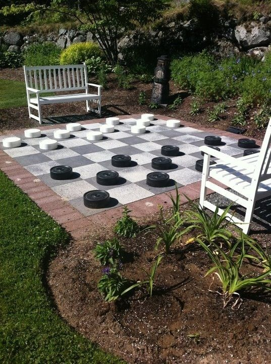 giant checkers-Backyard game. some shuffleboard sticks may be useful..